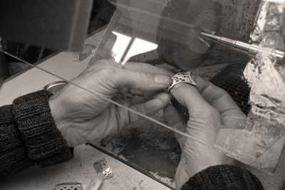 Handbrushing to perfect our sterling silver bangle caps